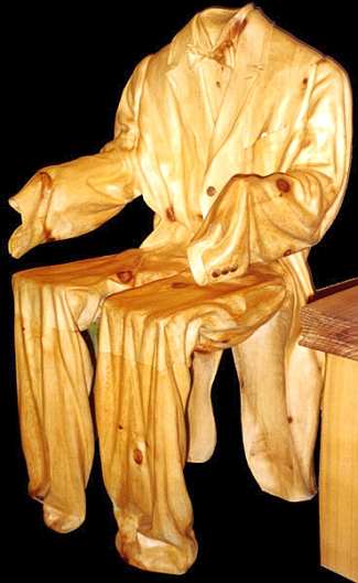 Carved_wooden_suit_chair